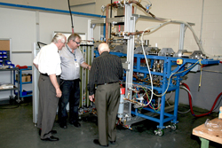 Mr. Milinkovic and his colleagues examining a vapour metallurgy prototype equipment