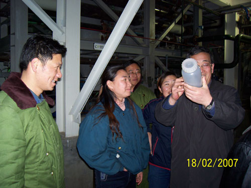 Chief Engineer, Mr. Piao, celebrating the first batch of nickel powder produced at the CVMR plant in Jilin